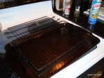 put meatloaf basket on a cookie sheet and spray with pam.